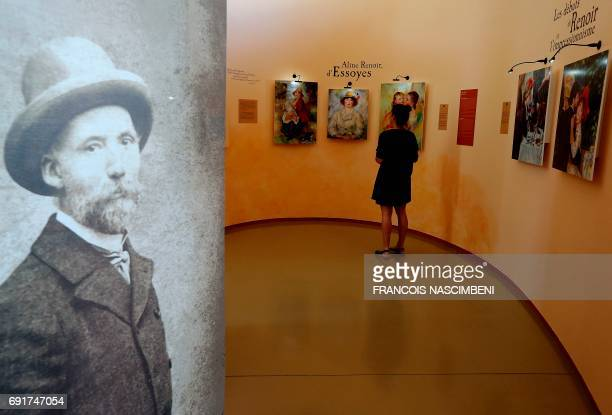 A woman visits an exhibition dedicated to French painter PierreAuguste Renoir on June 1 2017 in Essoyes central eastern France Renoir has spent time...