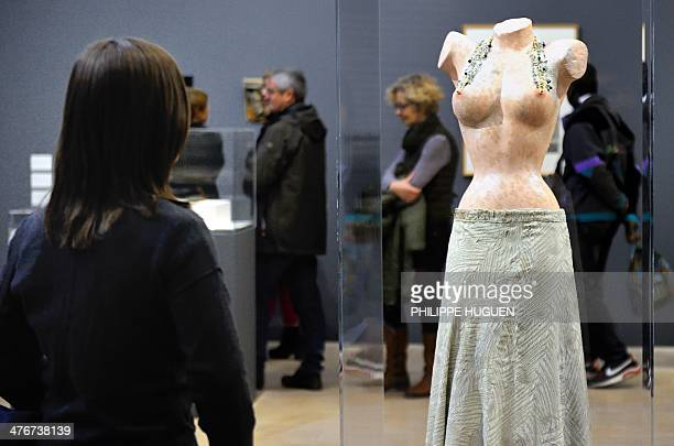 A woman visits an exhibition dedicated to the work of late Swiss artist Meret Oppenheim on February 25 2014 in Villeneuved'Ascq AFP PHOTO PHILIPPE...