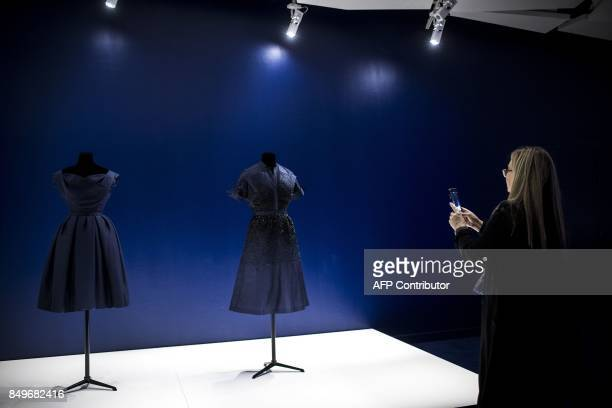 A woman visits an exhibition to celebrate the 70th anniversary of the Christian Dior brand at the Galeries Lafayette Haussmann in Paris on September...
