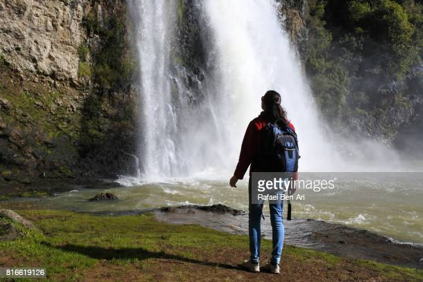 woman visits at hanua falls new zealand - rafael ben ari stock pictures, royalty-free photos & images