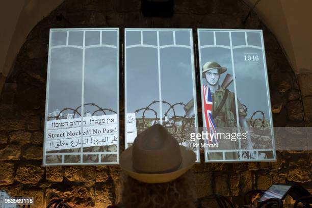 A woman visits 'London in Jerusalem' exhibition Which presents life in Jerusalem under the British Mandate at The Tower of David Museum on June 25...
