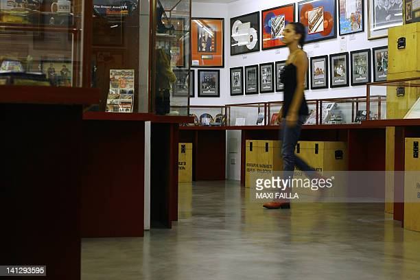 A woman visits on February 18 2011 the Beatles museum in Buenos Aires owned by Argentine Rodolfo Vazquez who is in the Guinness Book of Records for...