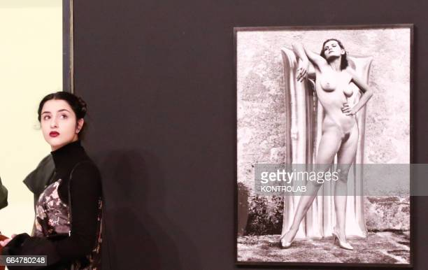 A woman visits the Big Nudes section of the Helmut Newton pictures exibition in PAN Art's palace in Naples on February 24 2017