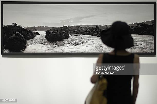 A woman visits the 'Congo' exhibition by photographers Alex Majoli and Paolo Pellegrin during the 46th annual Rencontres d'Arles photography festival...