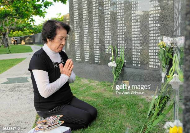 A woman visits the Cornerstone of Peace where the names of their bereaved family members and relatives engraved at the Peace Memorial Park on the...