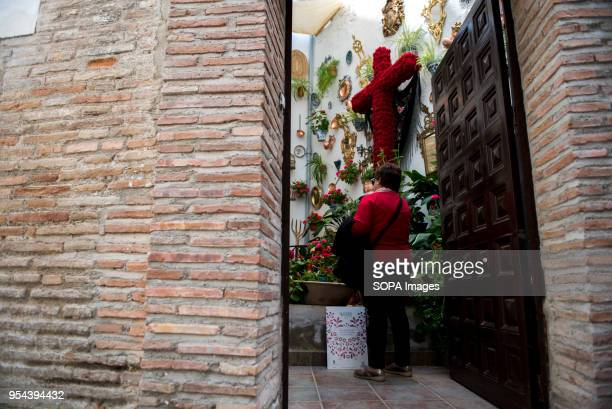 A woman visits the Cross of Carmelitas Descalzas convent situated in the neighbourhood of El Realejo in GranadaEl día de la Cruz or Día de las Cruces...