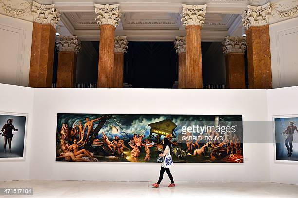 CAPTION** A woman visits the David LaChapelle exhibition 'After the Deluge' at the Palazzo delle Esposizioni on April 29 2015 in Rome The exhibition...