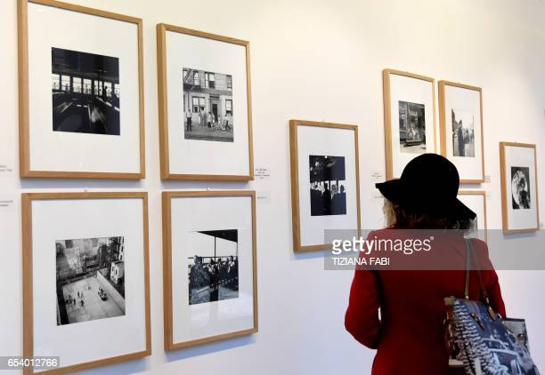 A woman visits the exhibition dedicated to late US photographer Vivian Maier during a press preview at Trastevere Museum in Rome on March 16 2017 /...