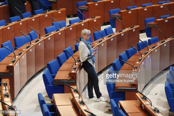 Woman visits the hemicycle of the Council of Europe during the open day celebrating the 70th Anniversary of the Council of Europe on May 5 in...