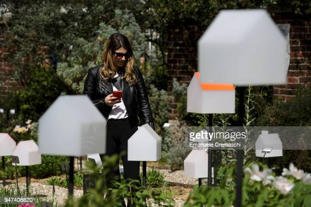A woman visits the installation 'smarTown' at the Brera Botanical Garden on April 16 2018 in Milan Italy Every year Salone and Fuorisalone define the...