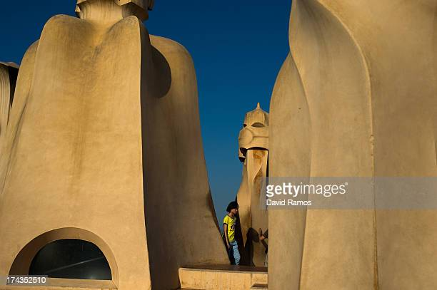 A woman visits the roof of Antoni Gaudi's building 'La Pedrera' or 'Casa Mila' on July 24 2013 in Barcelona Spain Foreign visitors to Spain set a new...