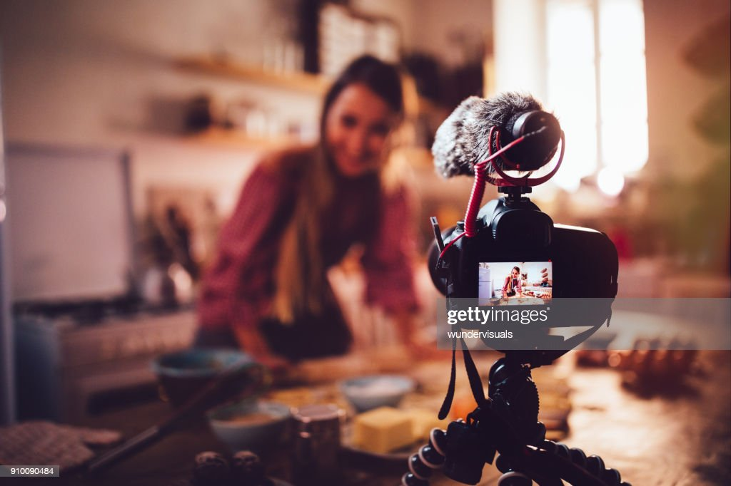 Woman vlogger baking and recording video for food channel : Stock Photo