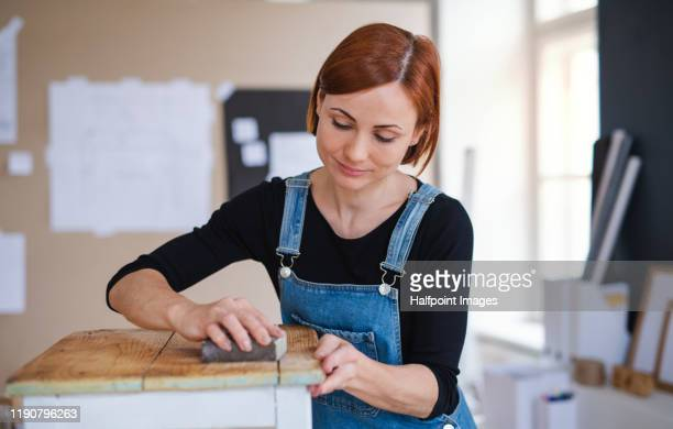 woman vlogger or blogger making video about old furniture restoration. - restoring stock pictures, royalty-free photos & images