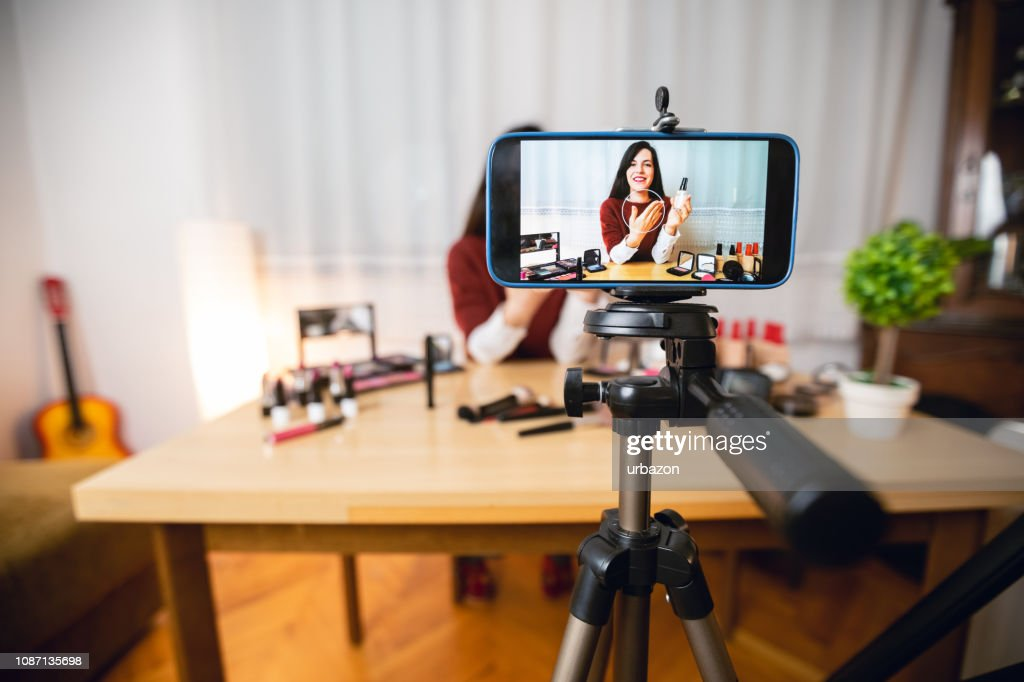 Woman vlogging about makeup : Stock Photo