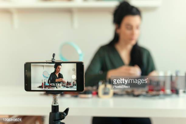 woman vlogging about make-up - social media marketing stock pictures, royalty-free photos & images