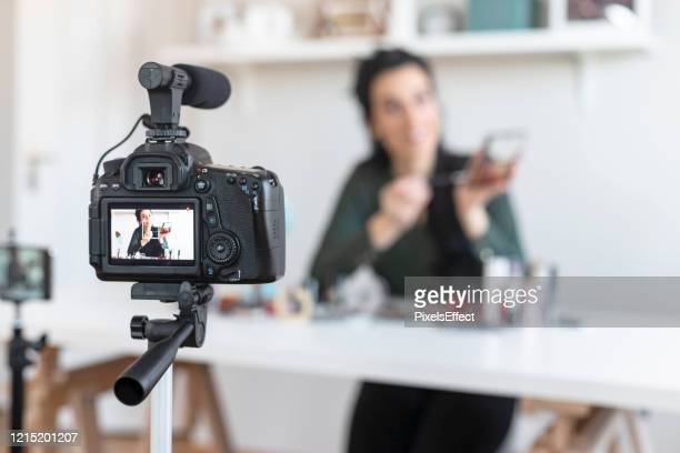 woman vlogging - promoter stock pictures, royalty-free photos & images
