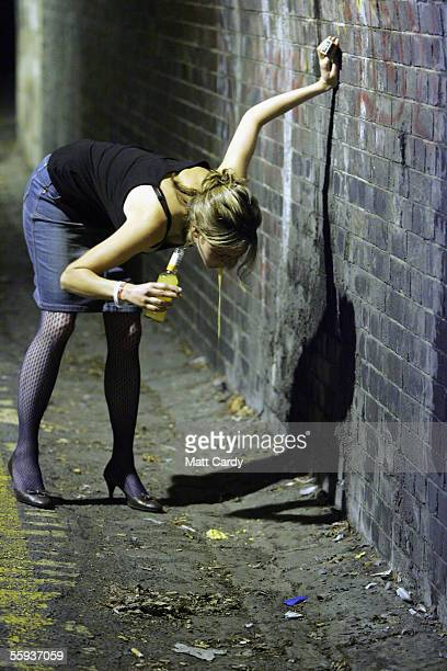 A woman vommits in the street after leaving a pub in Bath on October 15 2005 in Bath England Pubs and clubs prepare for the new Licensing laws due to...