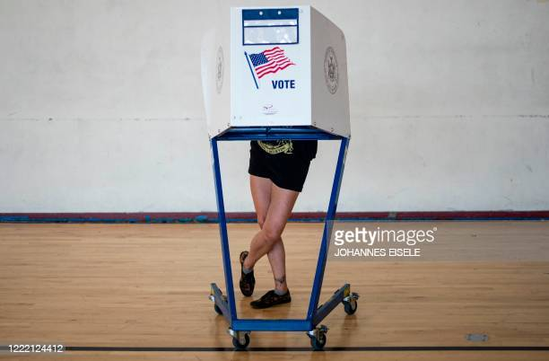 Woman votes at a polling site in Queens during the New York Democratic presidential primary elections on June 23, 2020 in New York City.