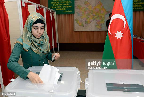 A woman votes at a polling station during a referendum on boosted presidency on September 26 2016 in Baku Azerbaijanis went to the polls on September...