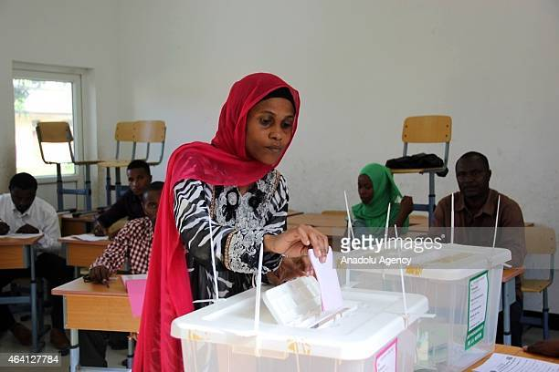 A woman votes at a polling station for the second round of the general elections in Moroni Comoros on February 22 2015