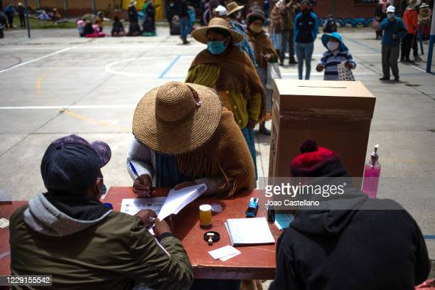 Woman votes at Antonio Diaz Villamil school during general elections day on October 18, 2020 in Achocalla, Bolivia. Bolivians head to the polls after...