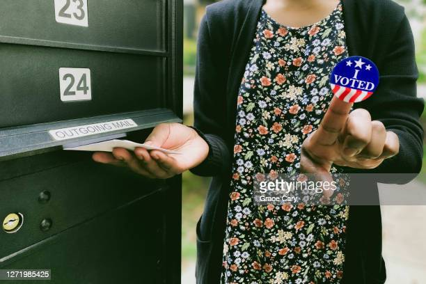 woman votes by mail - voting by mail stock pictures, royalty-free photos & images