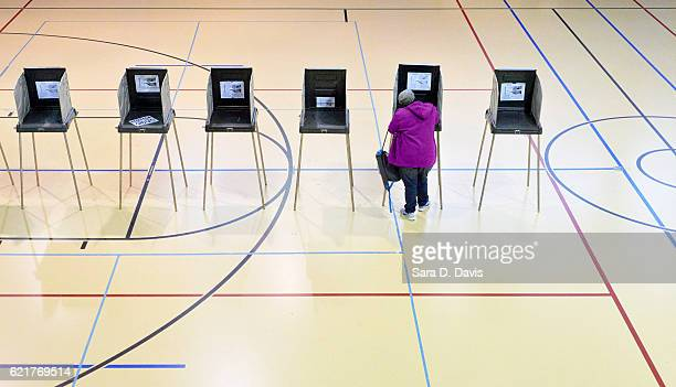 A woman votes on November 8 2016 in Durham North Carolina African American turn out to the polls was reporting low across the battleground state