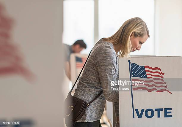 woman voting on election day - voting booth stock pictures, royalty-free photos & images