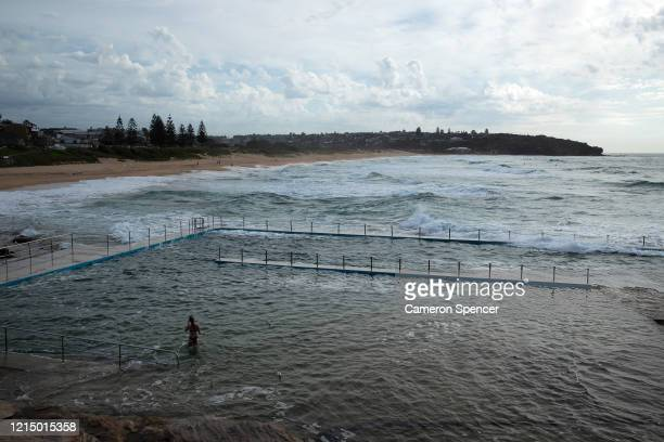 A woman wades in an ocean pool at Curl Curl Beach on March 25 2020 in Sydney Australia The state of New South Wales in Australia has the highest...