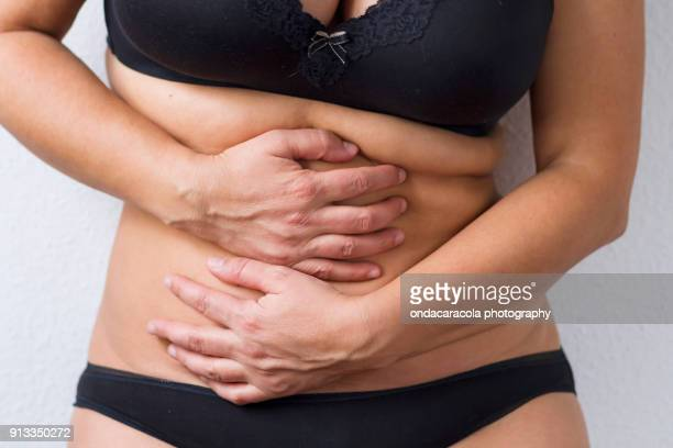 A woman waist with overweight