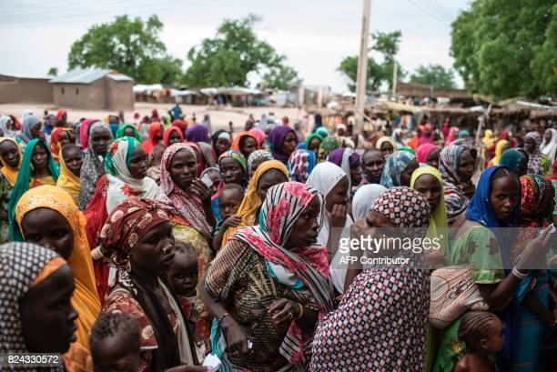Woman wait in queues to receive rations in the Rann InternallyDisplaced Peoples camp in northeastern Nigeria near the Cameroonian border on July 29...