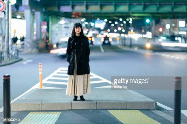 woman waiting alone at night - ginza stock pictures, royalty-free photos & images
