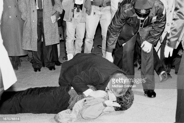 Woman waiting at John F. Kennedy International Airport for Pan Am flight 103 collapses at hearing the news of the Lockerbie bombing, New York, 21st...