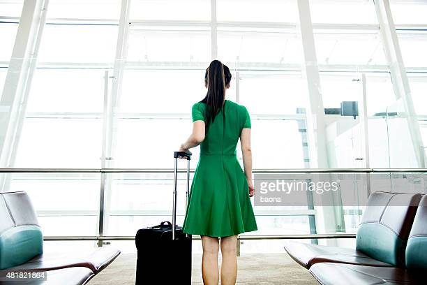Woman waiting at the airport