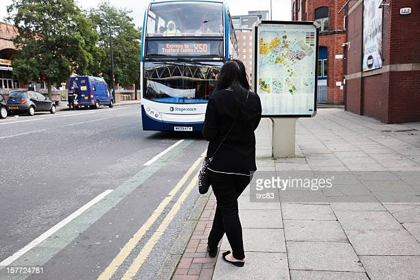 Woman waiting for a bus to stop