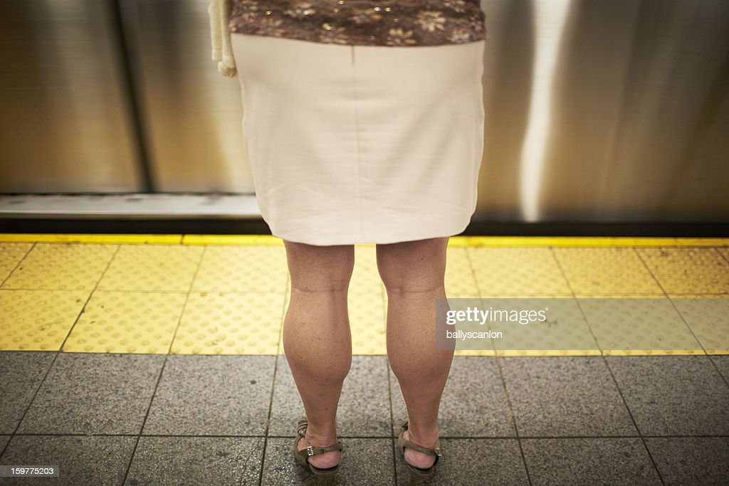 Woman waiting for a subway train : Stock Photo