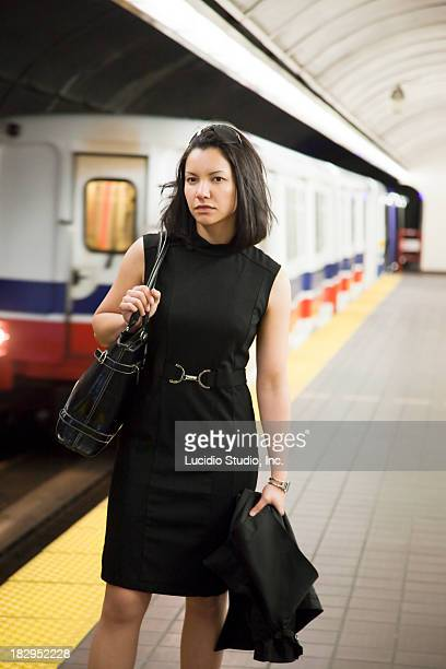 Woman waiting for a subway train.