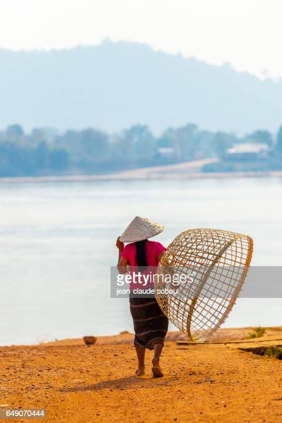 Woman waiting for an ambaradaire in laos