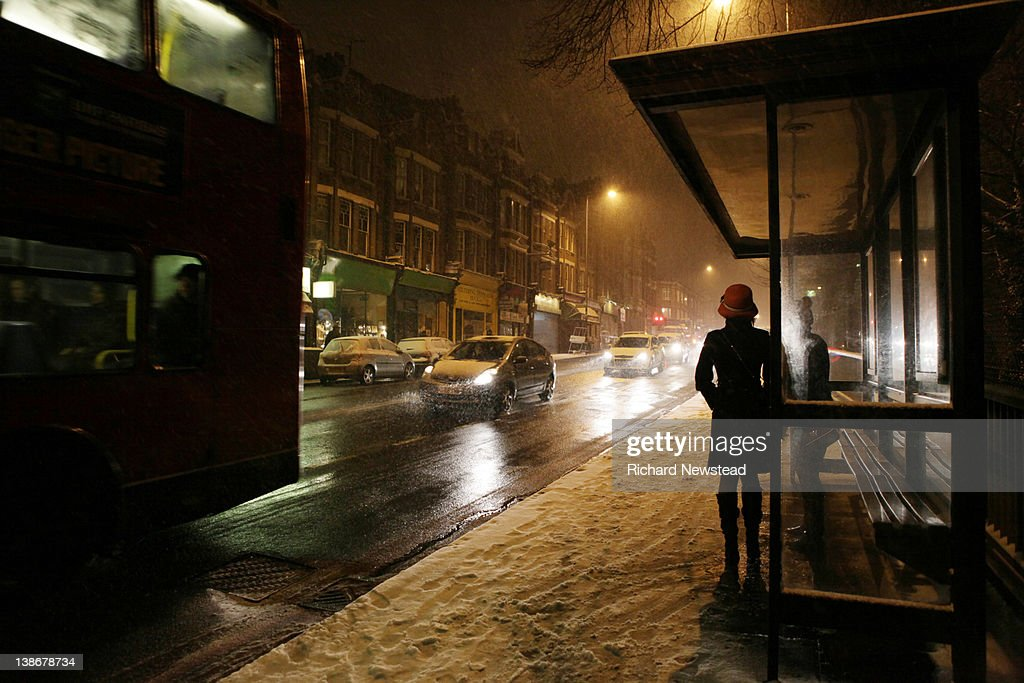 Woman waiting for bus : Stock Photo