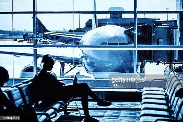 Woman waiting for flight at airport lounge