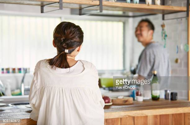 a woman waiting for her husband's dish to come up. - married stock pictures, royalty-free photos & images