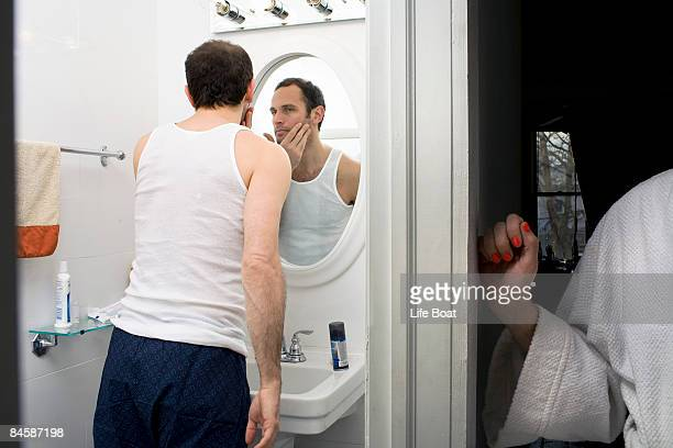 woman waiting for her man in the bathroom. - lingering stock pictures, royalty-free photos & images