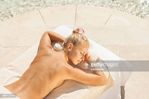 woman waiting for massage treatment at a luxury spa resort - sensual massage stock photos and pictures