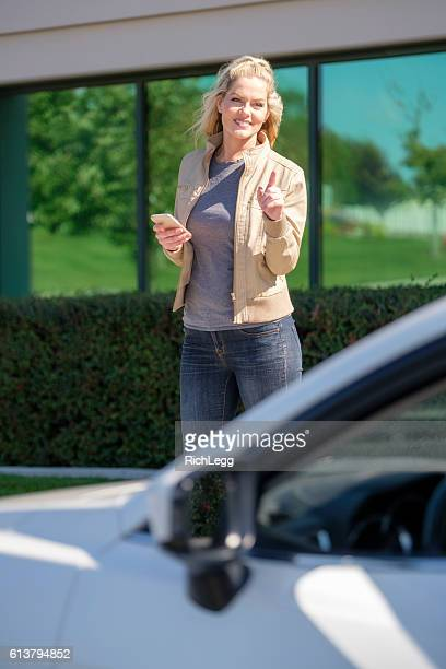 Woman Waiting for Ride Share Taxi