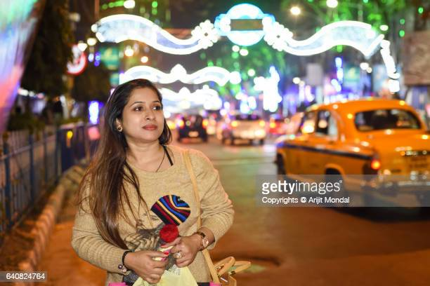 Woman Waiting For Taxi In Indian Street Real Person