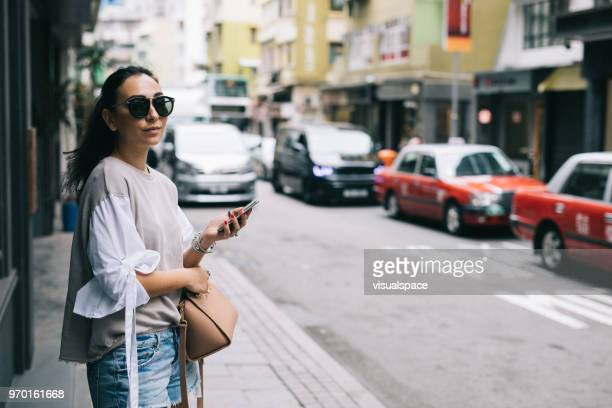 woman waiting for taxi - eurasia stock pictures, royalty-free photos & images