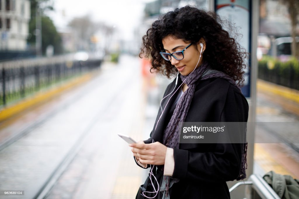 Woman waiting for train at the station : Stock Photo