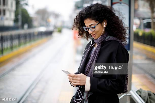 woman waiting for train at the station - rush hour stock pictures, royalty-free photos & images