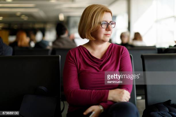 Woman waiting her flight at airport