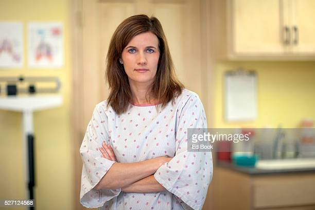 woman waiting in medical gown - hospital gown stock pictures, royalty-free photos & images